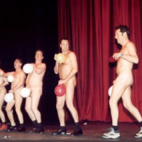 Brian Conely, comes on stage to surprise the Naked balloon dancers, The Odd Balls