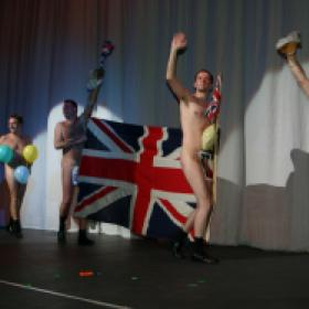 Brian Conely comes on stage to surprise the Naked balloon dancers, The Odd Balls